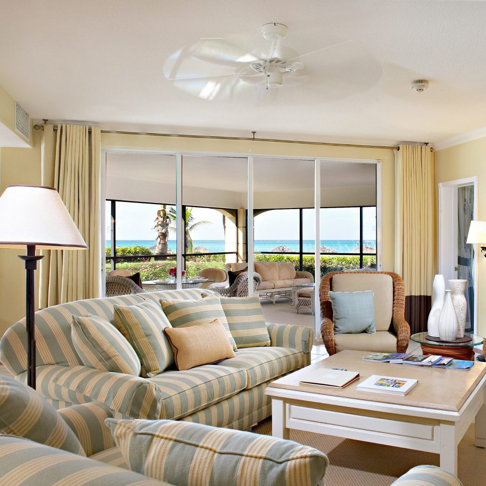 Balcony Beachfront Family Island Resort Scenic views Suite Tropical sofa living room property condominium home cottage Villa mansion Bedroom flat