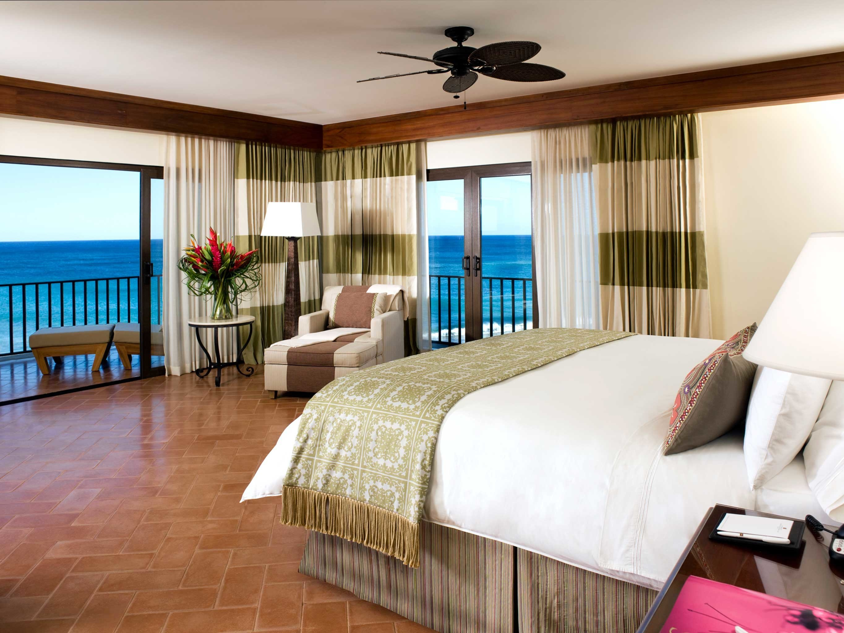 Balcony Beachfront Bedroom Lounge Luxury Scenic views Terrace Tropical property Suite home condominium living room cottage bed sheet