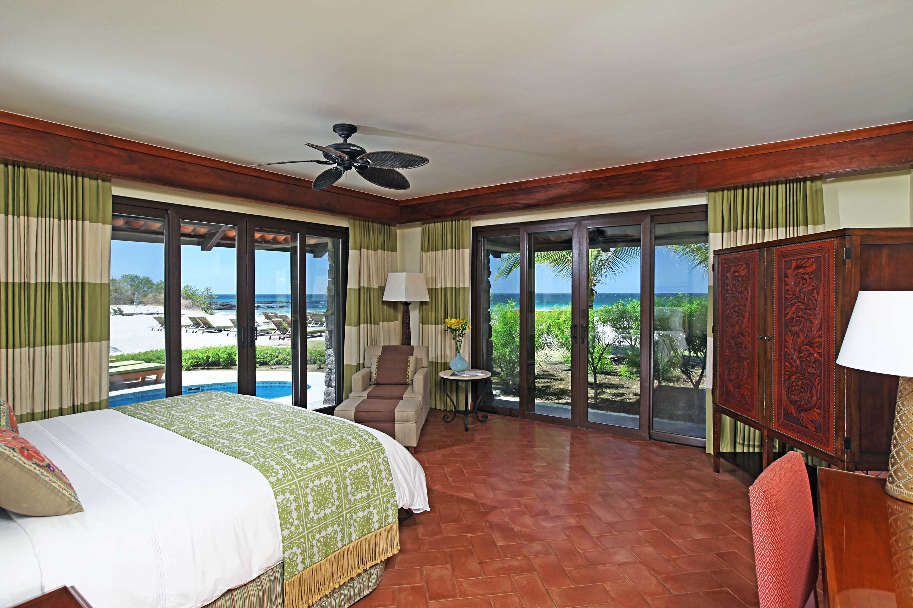 Balcony Beachfront Bedroom Lounge Luxury Scenic views Terrace Tropical property Resort house home cottage Villa Suite