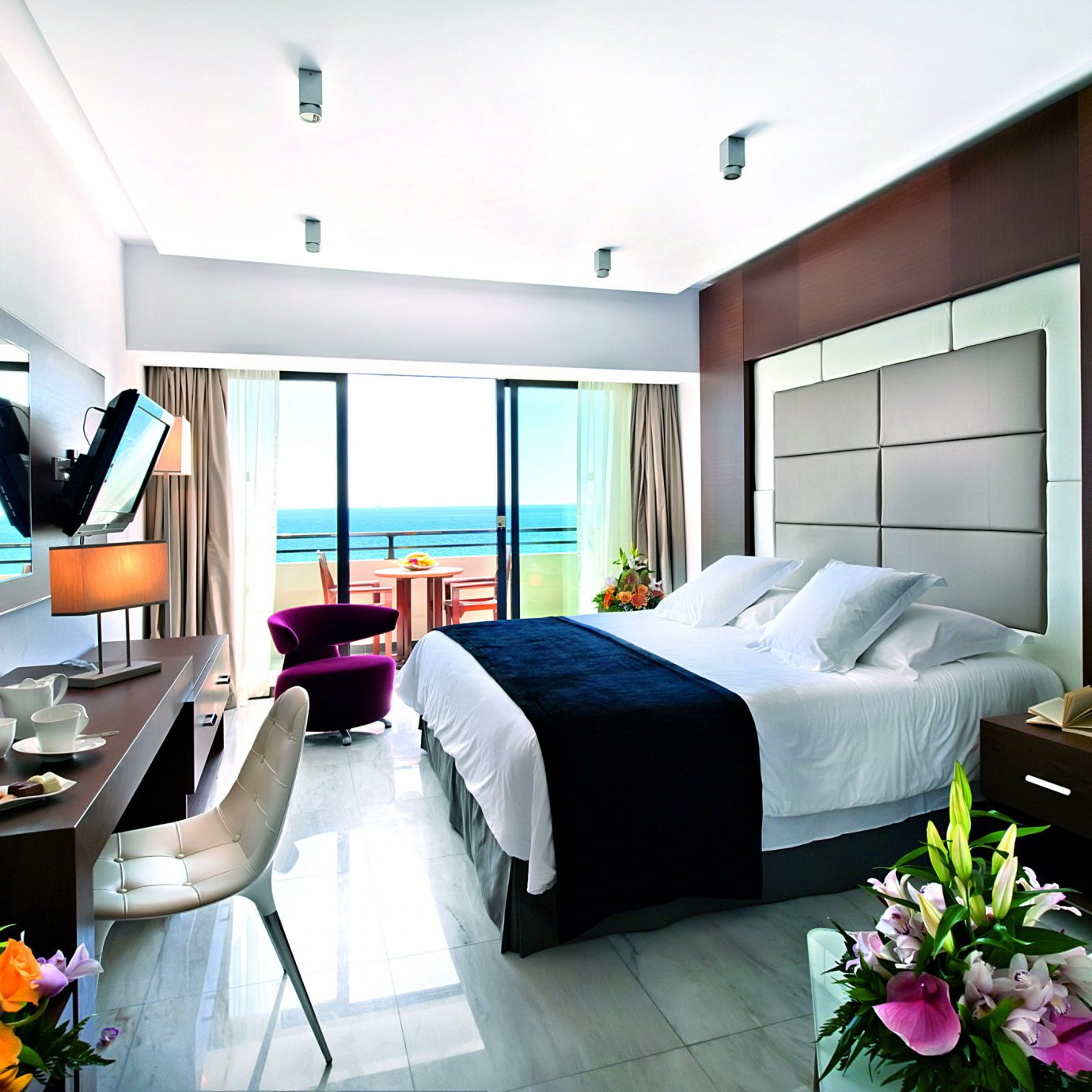 Balcony Beachfront Bedroom Luxury Modern Romantic Scenic views Suite property condominium living room flower home