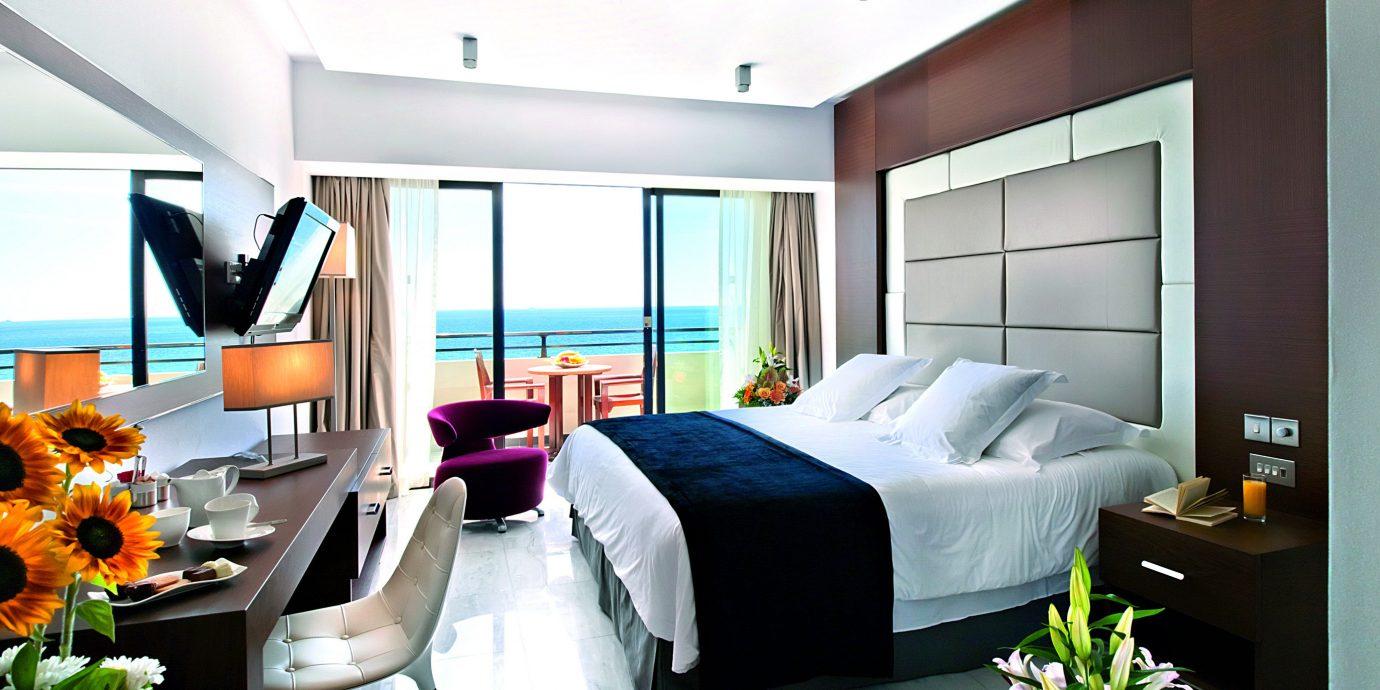 Balcony Beachfront Bedroom Luxury Modern Romantic Scenic views Suite property condominium living room flower home