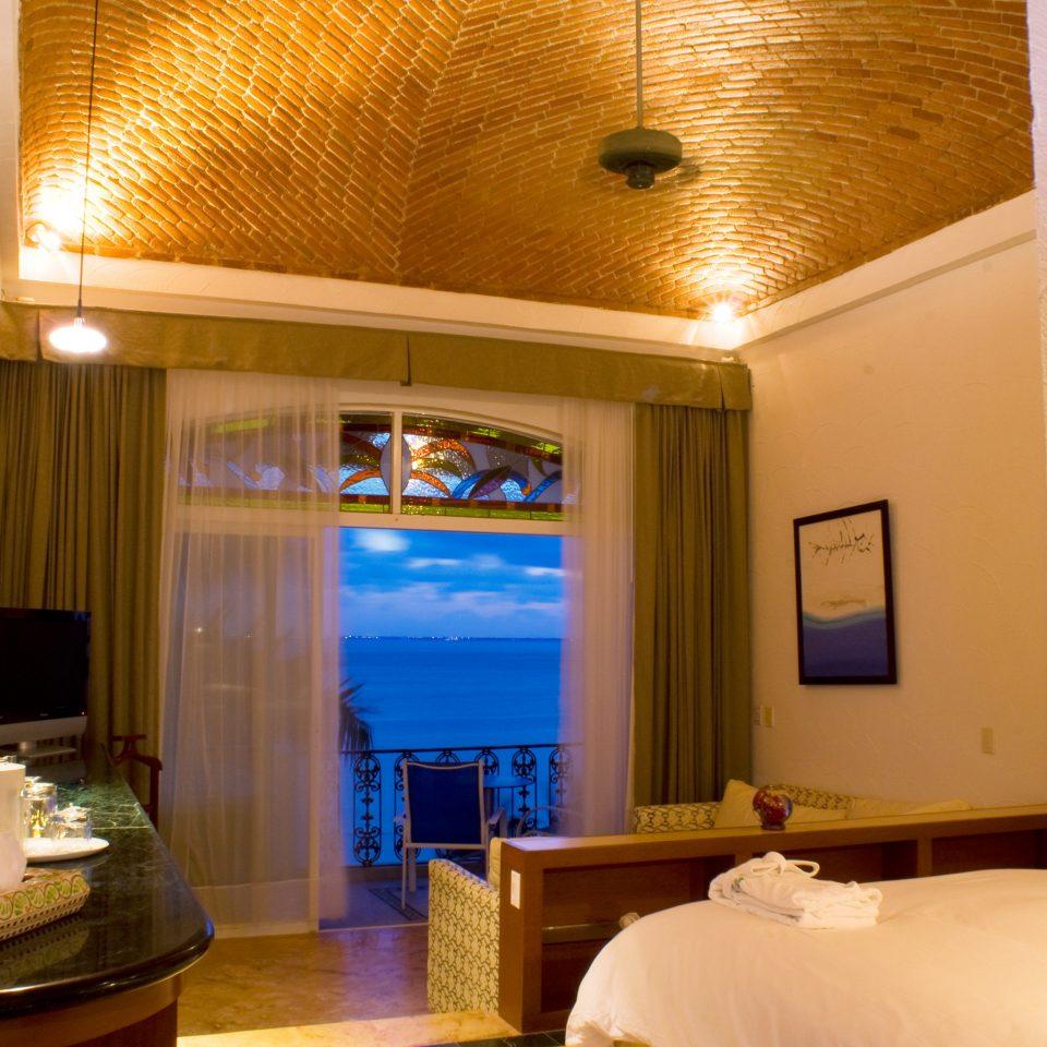 Balcony Beachfront Bedroom Luxury Scenic views Waterfront property Suite Resort swimming pool Villa