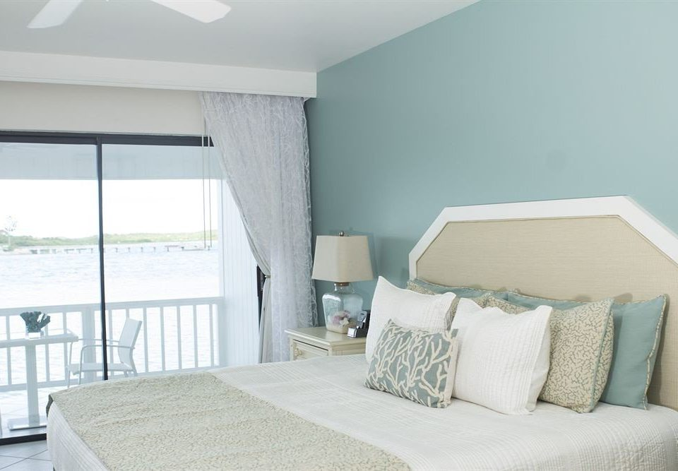 Balcony Beachfront Bedroom Ocean Patio Scenic views Suite property cottage living room home pillow