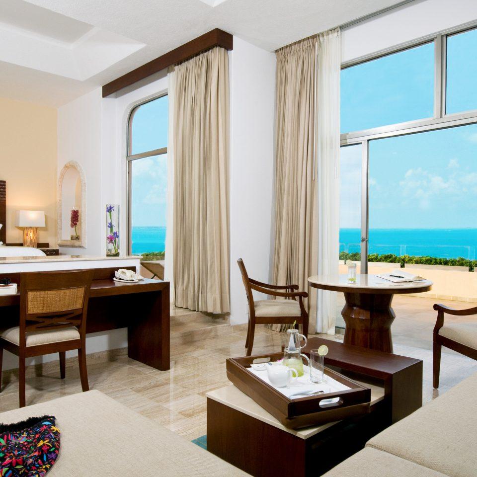 Balcony Beachfront Bedroom Scenic views Suite property condominium Resort home living room Villa cottage overlooking