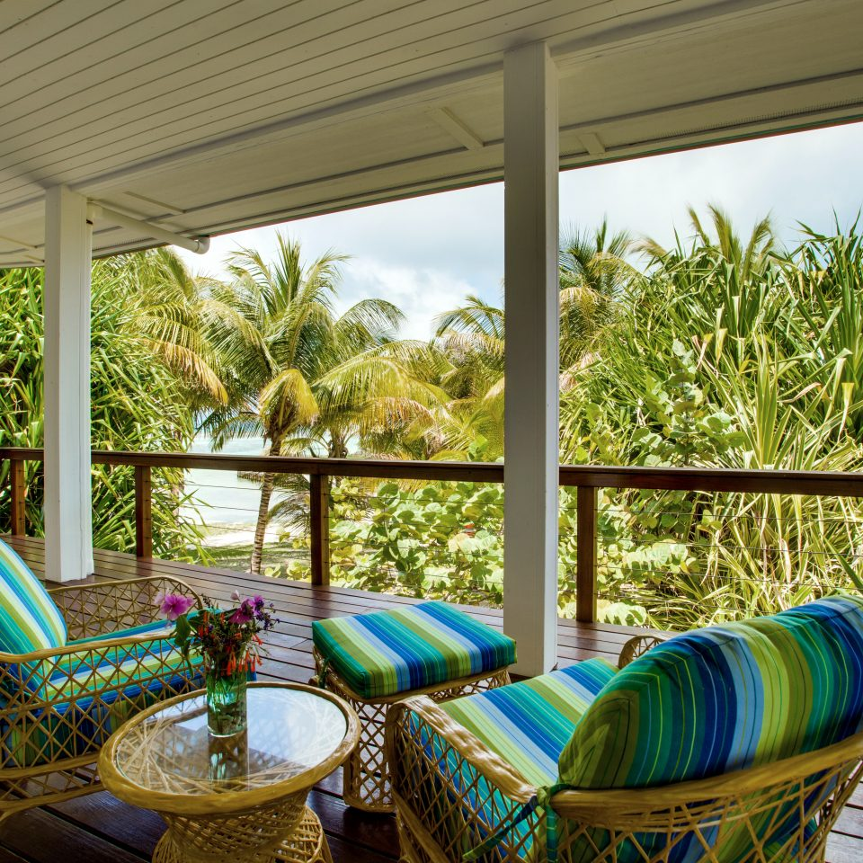 Balcony Beachfront Budget Family Island Tropical property Resort swimming pool house backyard Villa home blue cottage living room porch colorful