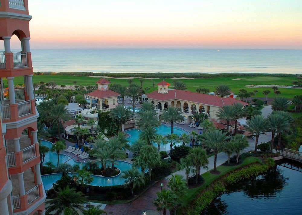 Balcony Beachfront Buildings Exterior Pool Resort Scenic views sky water amusement park overlooking beautiful shore