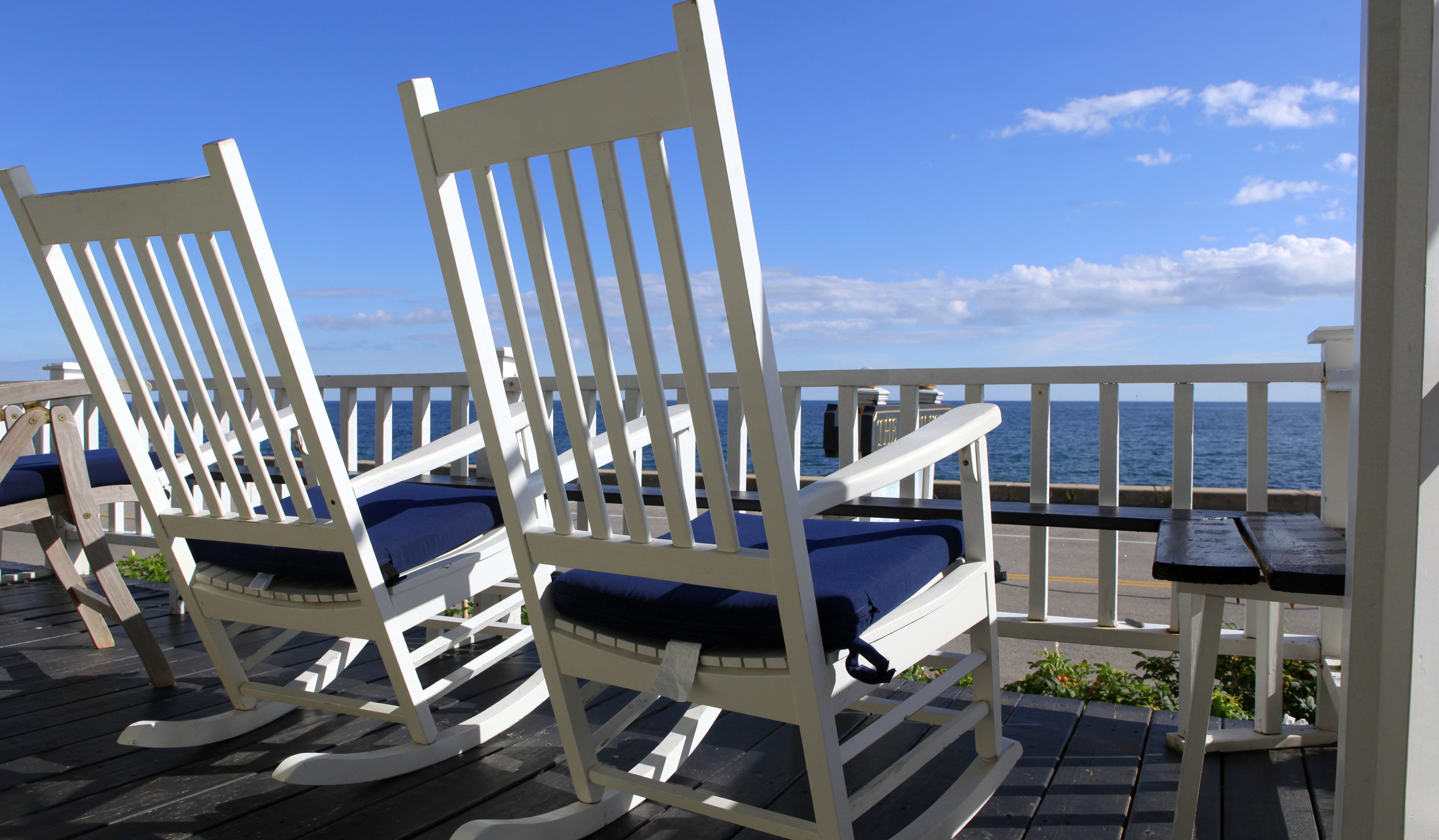 Balcony Beachfront Country Hotels Inn Patio Scenic views Waterfront chair property condominium marina dock Dining white headquarters lawn Resort porch overlooking set Deck dining table
