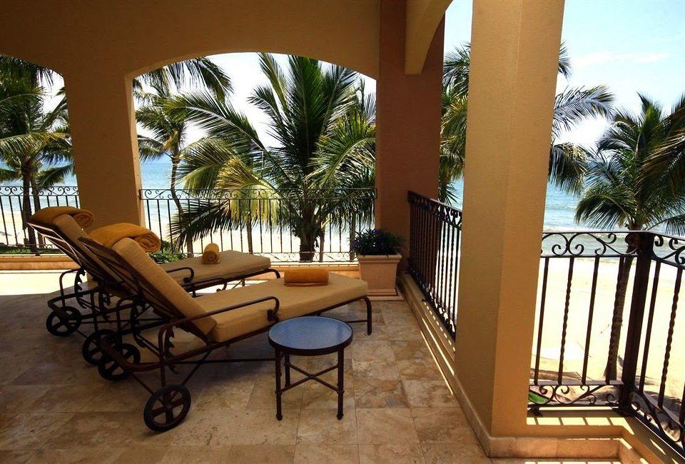Balcony Beachfront Lounge Scenic views Tropical tree property home Villa condominium Resort Courtyard cottage mansion outdoor structure backyard palm hacienda porch