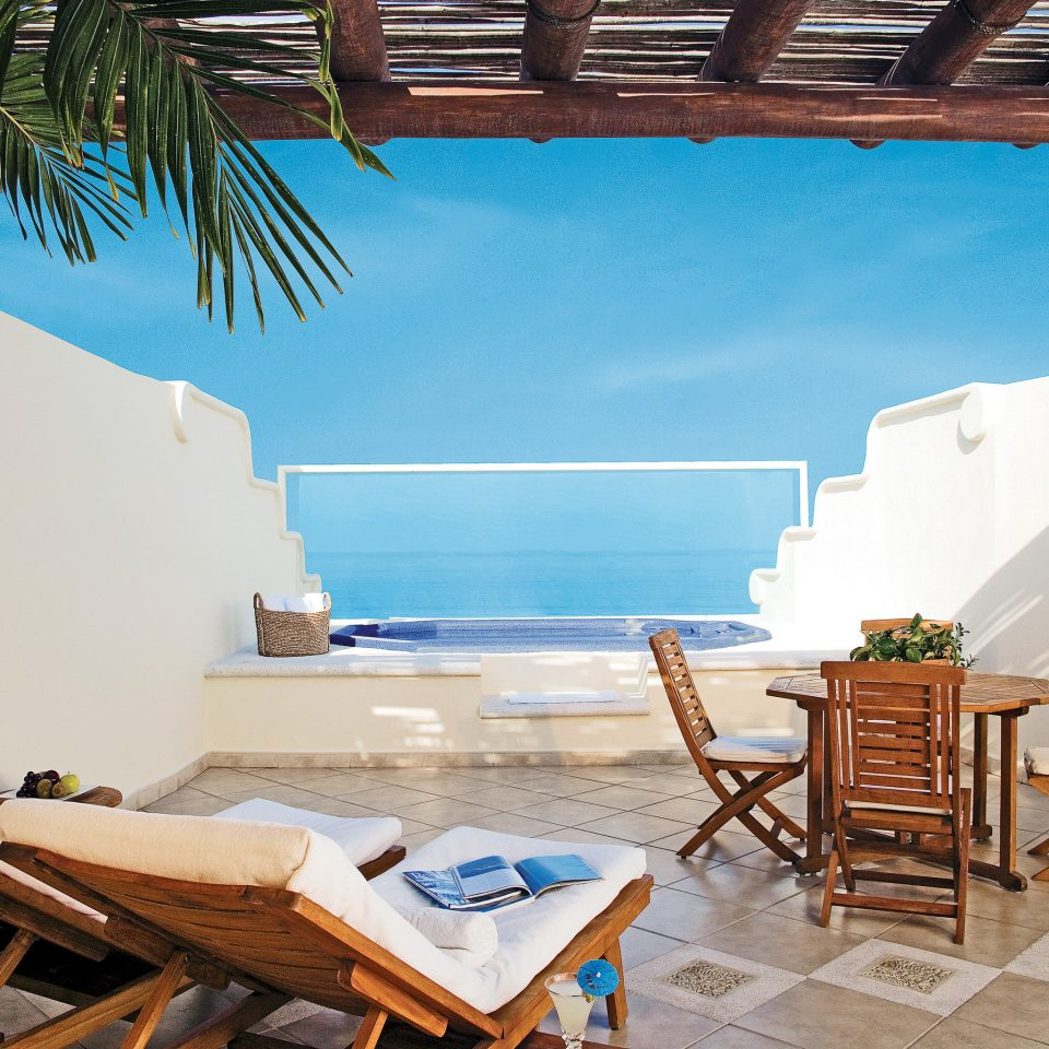Balcony Beachfront Elegant Lounge Patio Scenic views chair property leisure house home Resort Villa cottage living room swimming pool Deck
