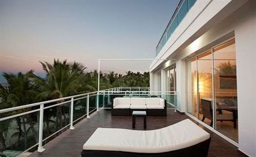 Balcony Beachfront Deck Hip Lounge building property condominium Villa Resort swimming pool