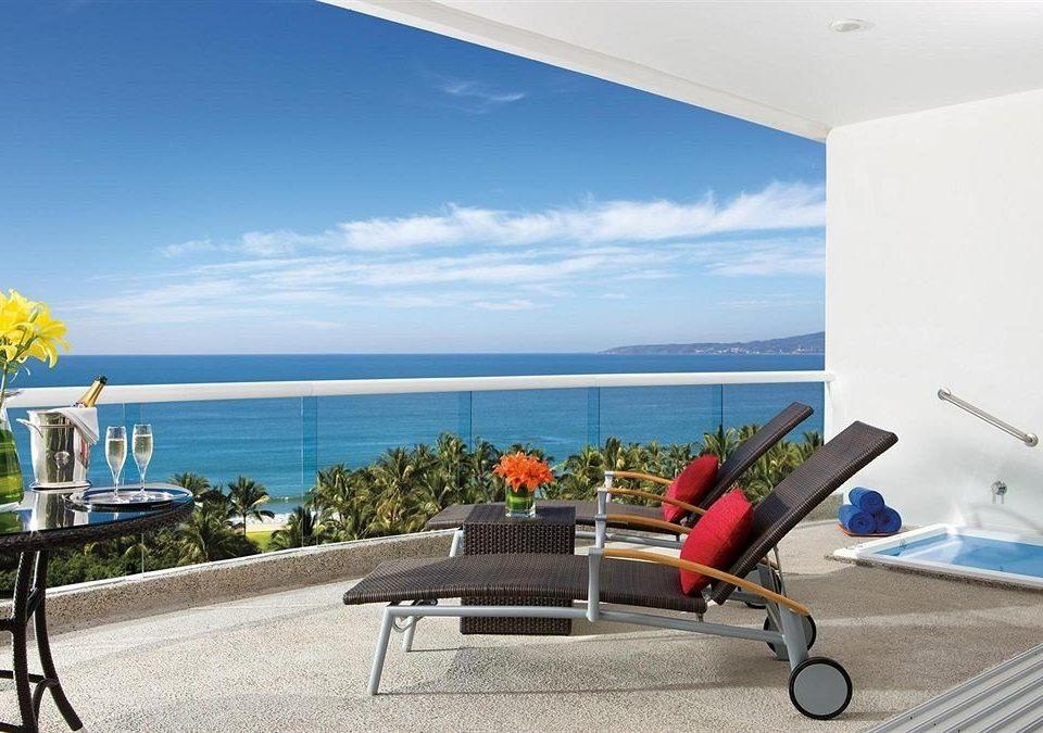 Balcony Beachfront Honeymoon Lounge Romance Scenic views leisure chair property Villa home condominium caribbean Resort cottage overlooking Deck