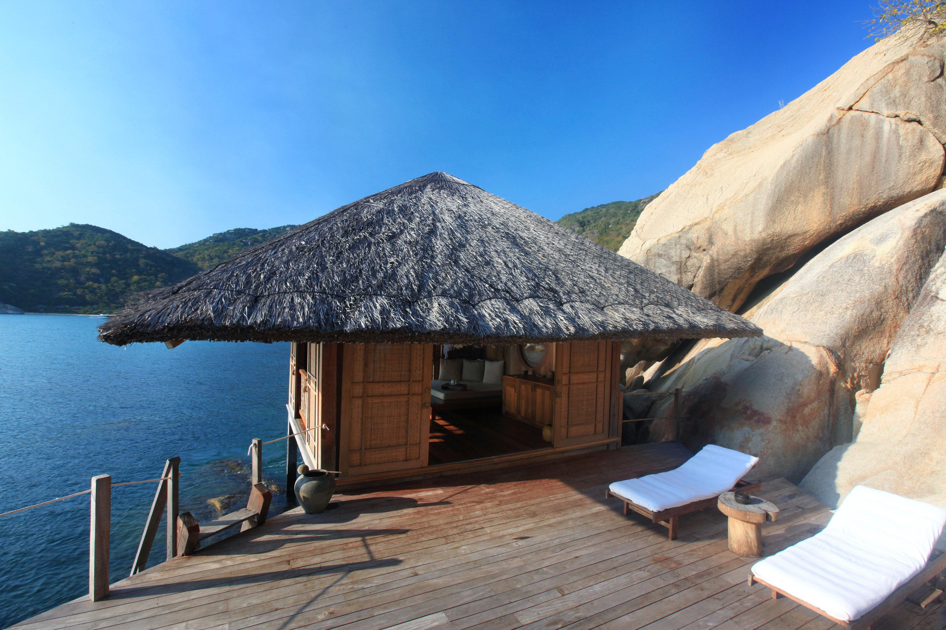 Balcony Beachfront Deck Hotels Jungle Romance Scenic views Terrace Tropical Waterfront sky mountain hut Nature Sea overlooking stone