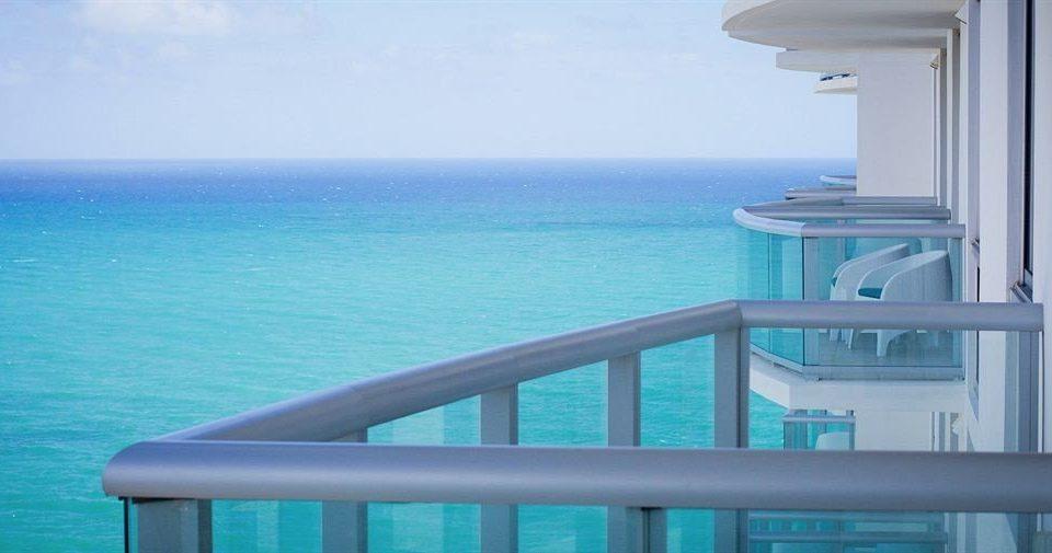 Balcony Beachfront Ocean Scenic views water sky blue property caribbean swimming pool Sea condominium Resort Deck overlooking shore