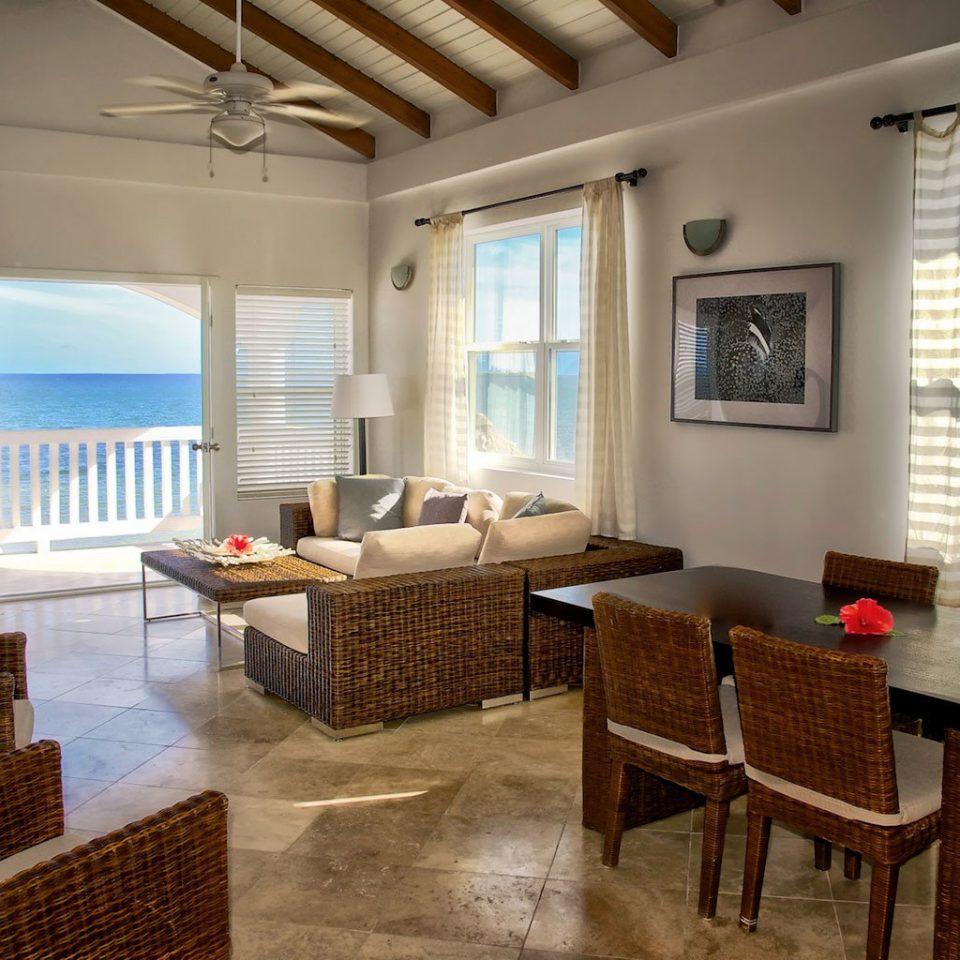 Balcony Beachfront Deck Resort Scenic views property living room chair home hardwood condominium cottage Villa Suite farmhouse