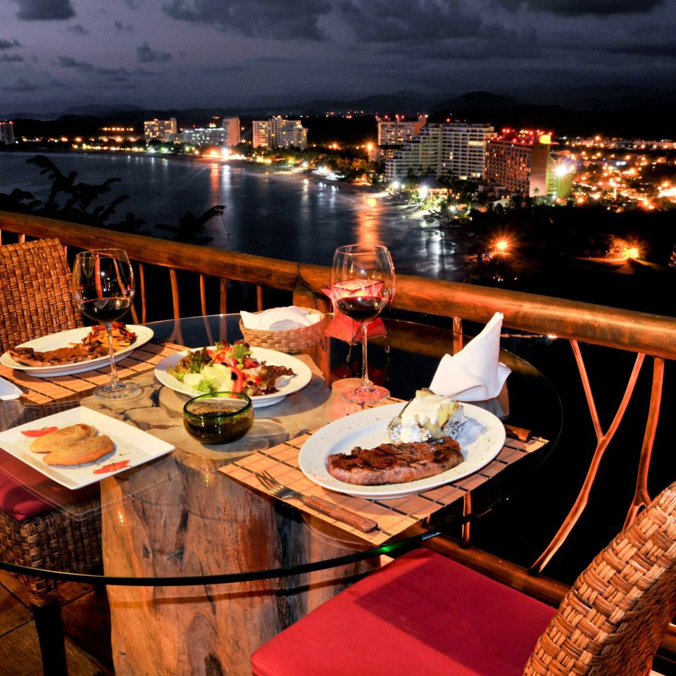 Balcony Beachfront Drink Eat Resort Scenic views Tropical Waterfront night restaurant evening vehicle set dining table