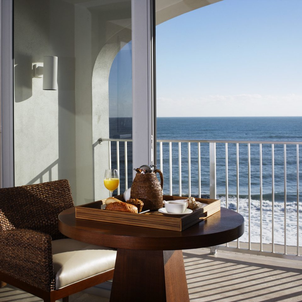 Balcony Beachfront Drink Eat Scenic views property building condominium home Villa living room outdoor structure overlooking