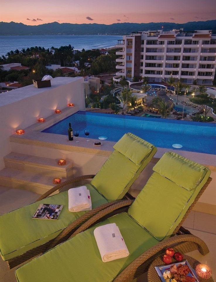 Balcony Beachfront Drink Honeymoon Hot tub/Jacuzzi Ocean Romance Romantic Scenic views Suite Sunset Terrace Tropical Wine-Tasting sky leisure swimming pool Resort Water park