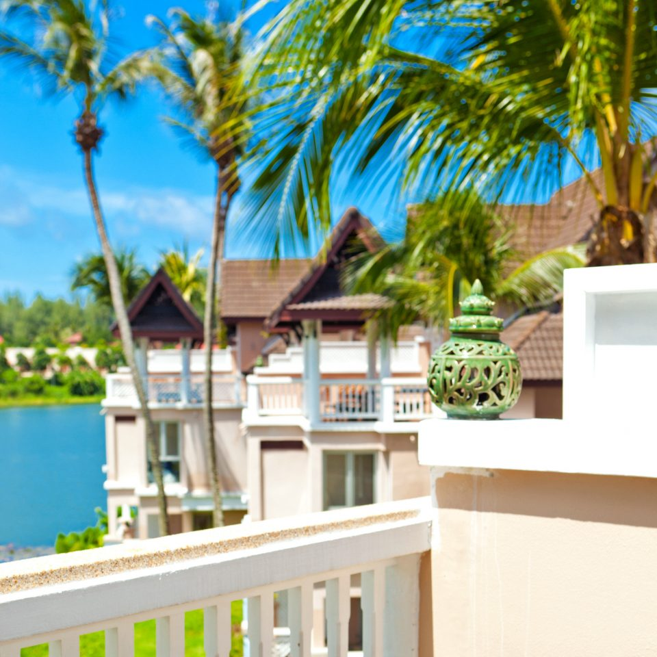 Balcony Beachfront Exterior Family Island Ocean Resort Sea Tropical Waterfront tree palm property caribbean home condominium arecales Villa swimming pool plant