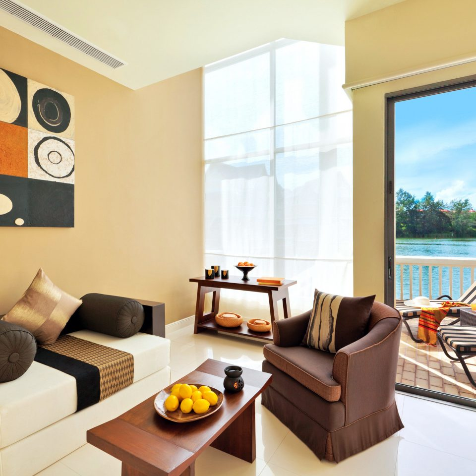 Balcony Beachfront Family Island Resort Suite Tropical Waterfront living room property condominium home hardwood Villa Modern