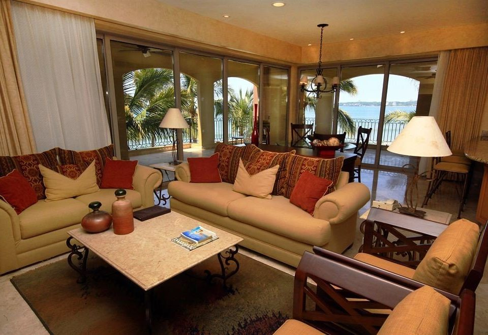 Balcony Beachfront Lounge Suite sofa living room property home cottage condominium Villa Resort lamp leather