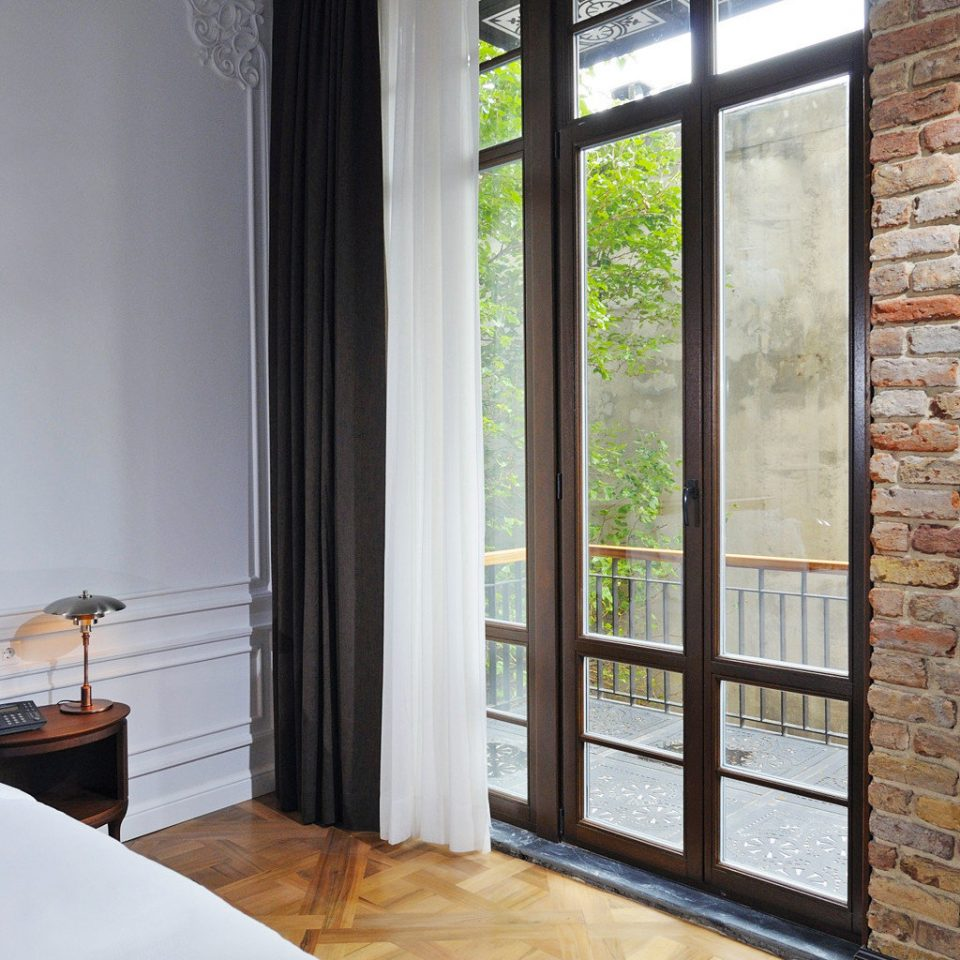 Balcony Bedroom Boutique Elegant property house home hardwood living room cottage curtain door window treatment farmhouse