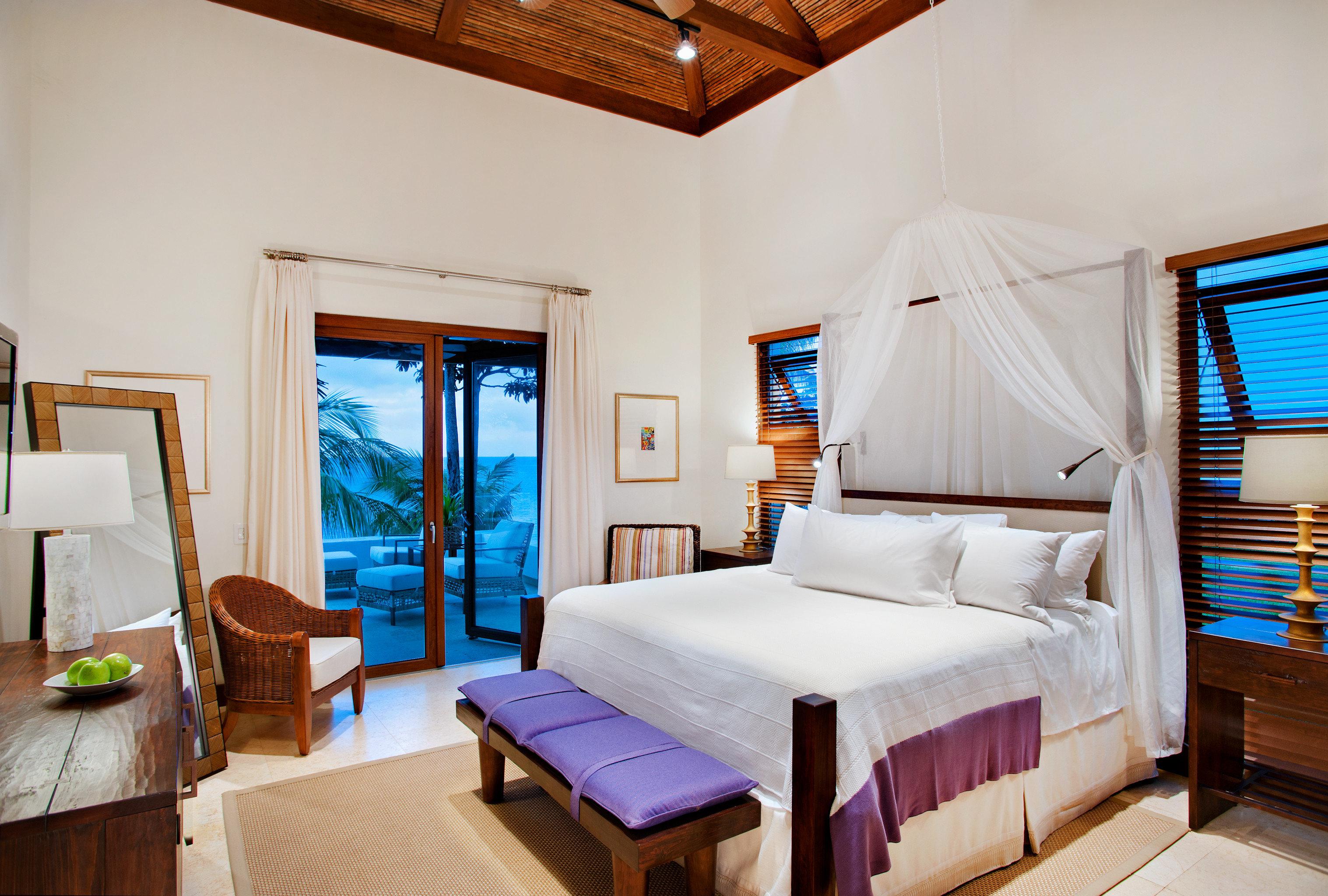 Balcony Bedroom Classic Eco Island Romance Scenic views Waterfront property Resort Suite Villa cottage living room