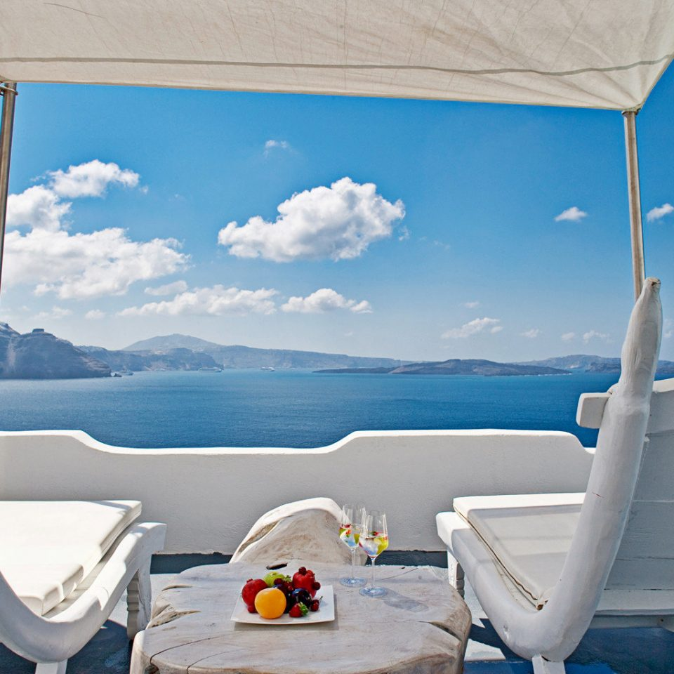 Balcony Bedroom Classic Elegant Hotels Island Luxury Romantic Scenic views Trip Ideas Waterfront sky blue Sea wind day