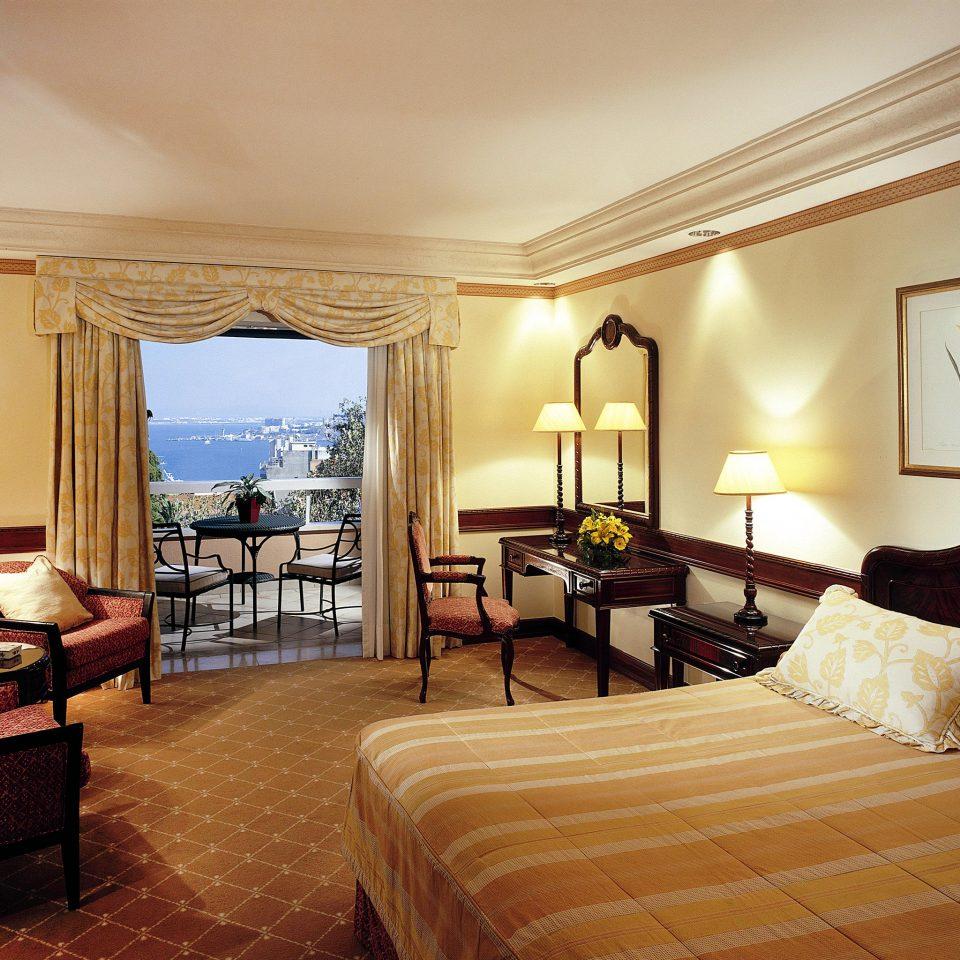 Balcony Bedroom Classic Historic Scenic views sofa property Suite scene living room Villa Resort cottage lamp