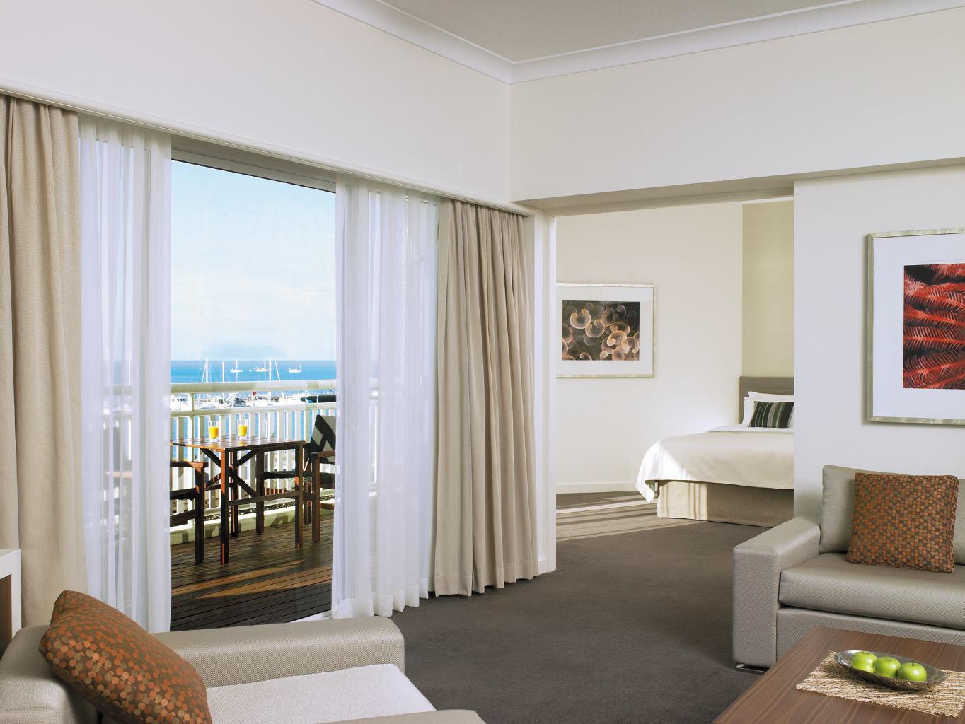 Balcony Classic Luxury Scenic views Suite Waterfront sofa living room property home condominium curtain window treatment Bedroom flat