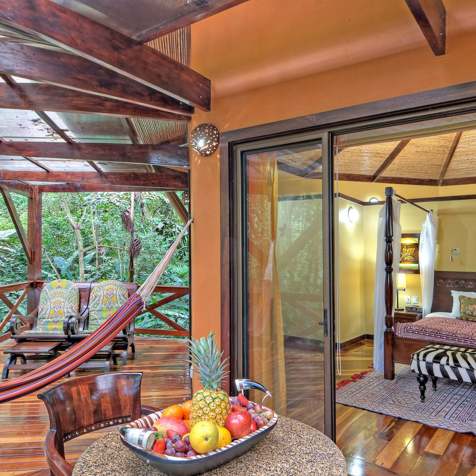 Balcony Bedroom Country Deck Eco Jungle Romantic Rustic Scenic views Suite property home house cottage porch Villa farmhouse Resort outdoor structure log cabin living room