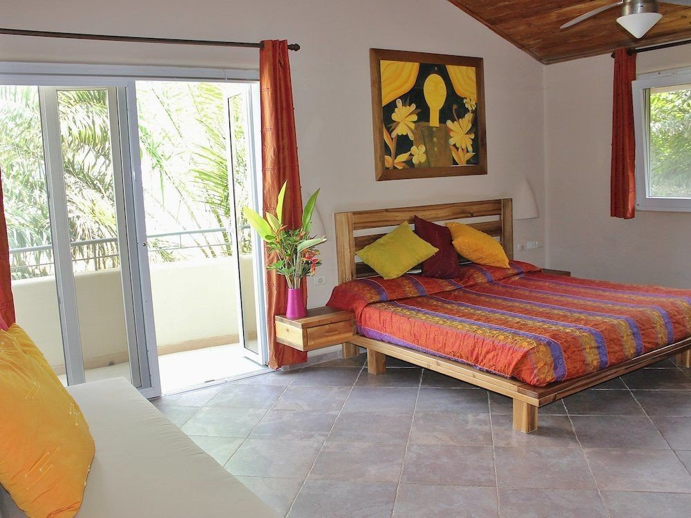 Balcony Bedroom Country Patio Suite Tropical property cottage red Villa bed sheet living room