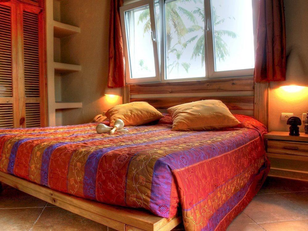 Balcony Bedroom Country Patio Suite Tropical property cottage bed sheet hardwood bed frame colored
