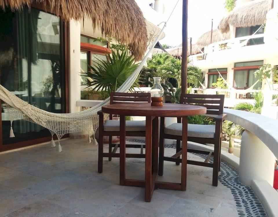 Balcony Bedroom Elegant Luxury Modern Scenic views Suite property Villa Resort hacienda restaurant condominium cottage home Courtyard mansion outdoor structure dining table