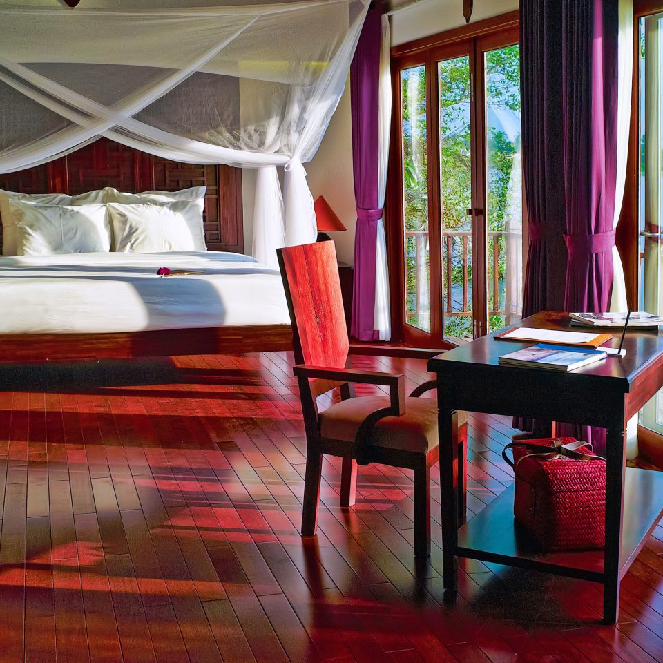 Balcony Bedroom Cultural Jungle Nature River Scenic views Villa Waterfront chair color Resort house restaurant home Suite cottage