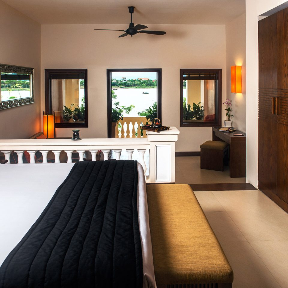 Balcony Bedroom Cultural Jungle River Scenic views Tropical Waterfront property Suite living room home hardwood cottage condominium Villa orange clean flat