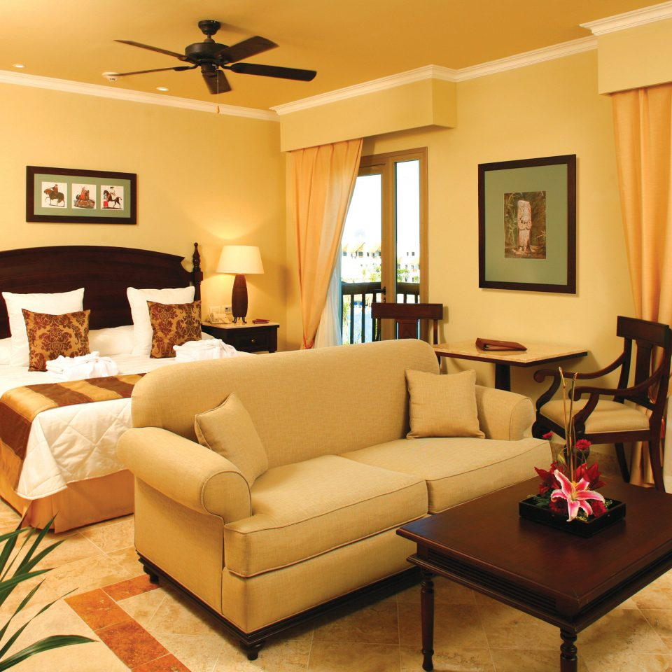 Balcony Bedroom Elegant Hip Lounge Luxury Romantic Scenic views Suite living room property home condominium Villa hardwood cottage flat leather