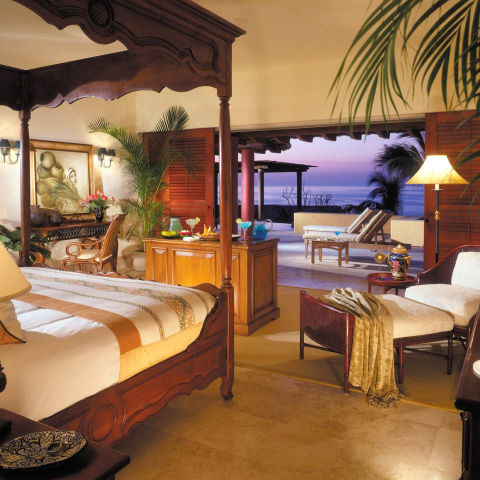 Balcony Bedroom Elegant Hip Luxury Modern Scenic views Suite property living room home Villa Resort cottage mansion