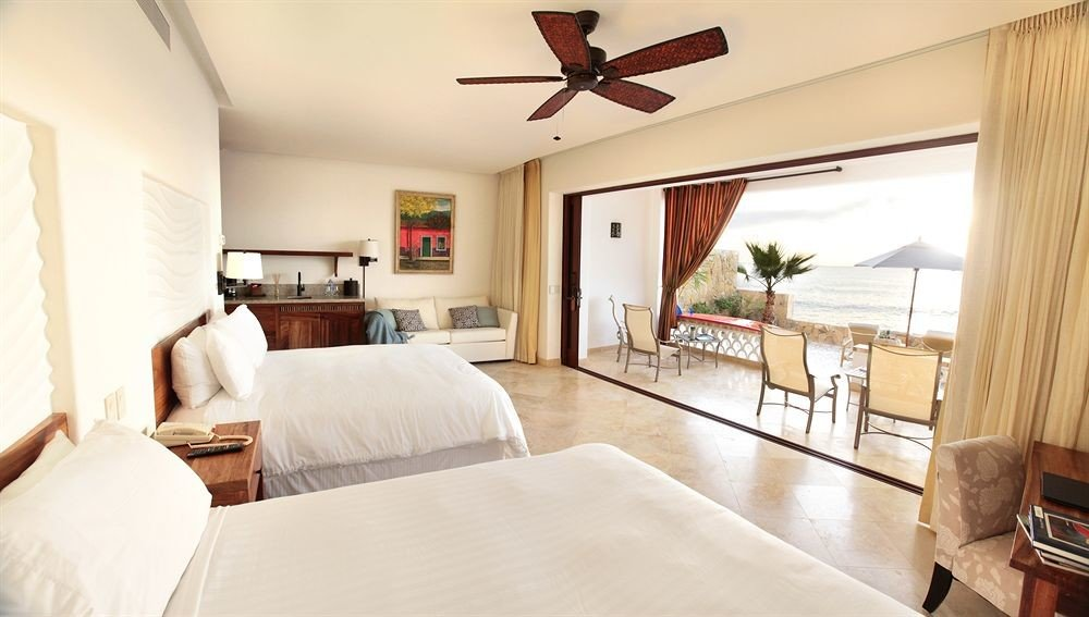 Balcony Bedroom Elegant Luxury Scenic views Suite property home cottage living room hardwood Villa white farmhouse