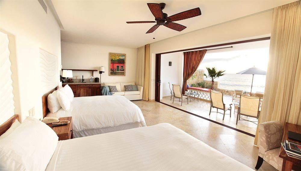 Balcony Bedroom Elegant Luxury Scenic views Suite property home cottage living room hardwood Villa white farmhouse
