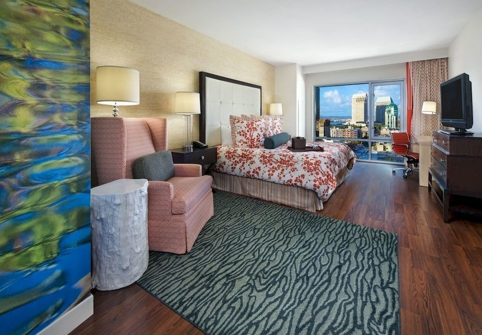 Balcony Bedroom Elegant Scenic views Suite property living room home hardwood cottage flooring condominium Villa
