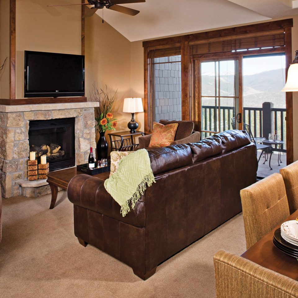 Balcony Fireplace Lodge Rustic Scenic views Suite sofa living room property home cottage hardwood Bedroom farmhouse Villa