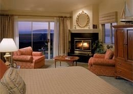 Balcony Bedroom Luxury Scenic views Suite property living room cottage Fireplace home condominium