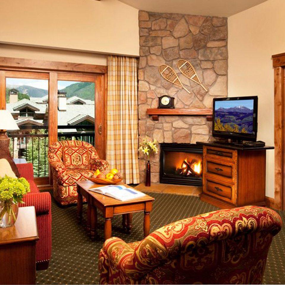 Balcony Bedroom Fireplace Resort property living room home Suite cottage hardwood Villa