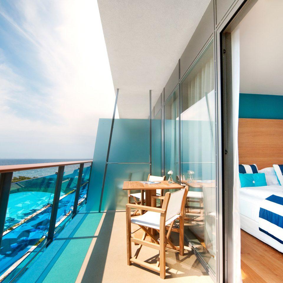 Balcony Bedroom Grounds Pool Romantic Scenic views Waterfront chair property Resort swimming pool condominium blue Villa Suite caribbean