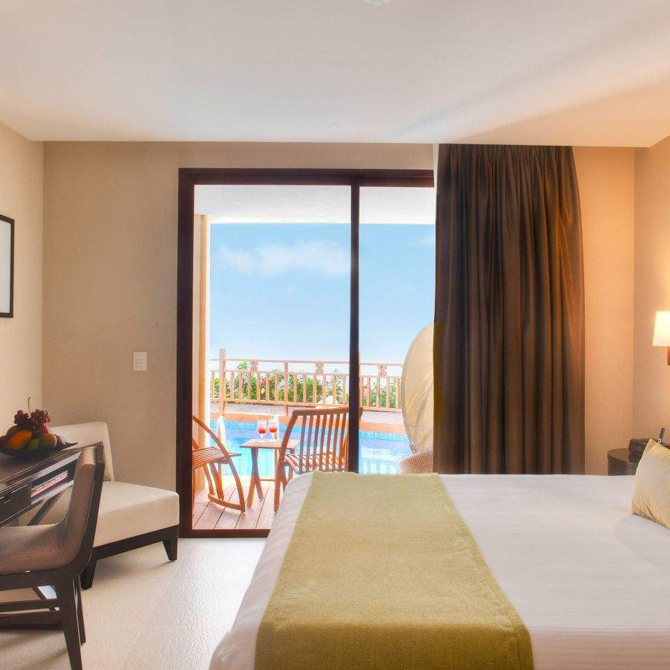 Balcony Bedroom Hip Luxury Scenic views Suite sofa property condominium living room home cottage flat