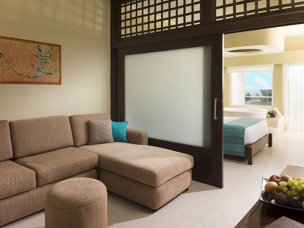 Balcony Bedroom Hip Luxury Modern Scenic views Suite living room property condominium home cottage couch sofa seat