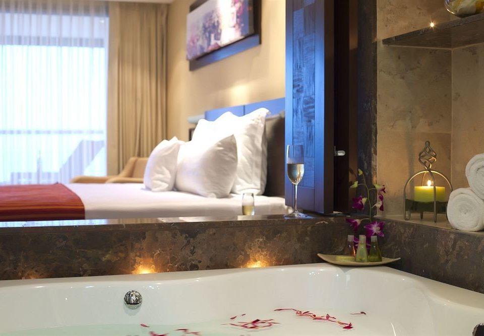 Balcony Bedroom Hip Luxury Scenic views Suite bathroom sink swimming pool property jacuzzi vessel counter bathtub colored