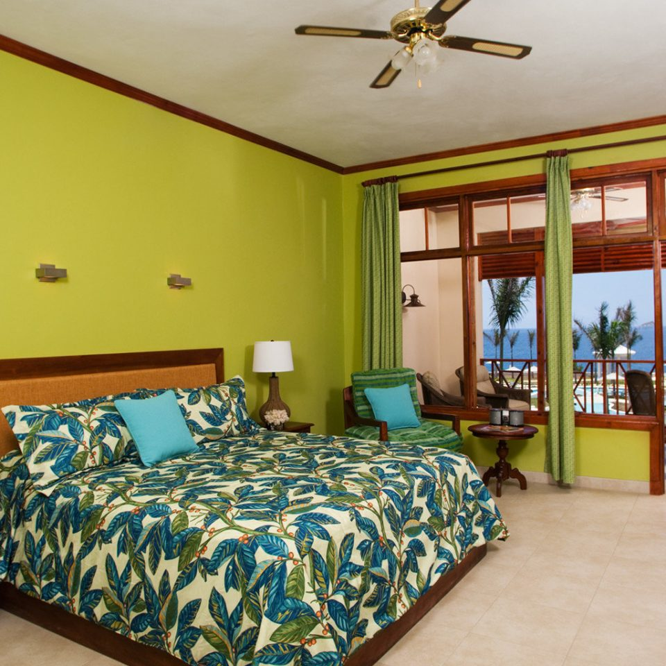 Balcony Bedroom Island Scenic views Tropical property yellow cottage home Suite Resort Villa condominium living room lamp