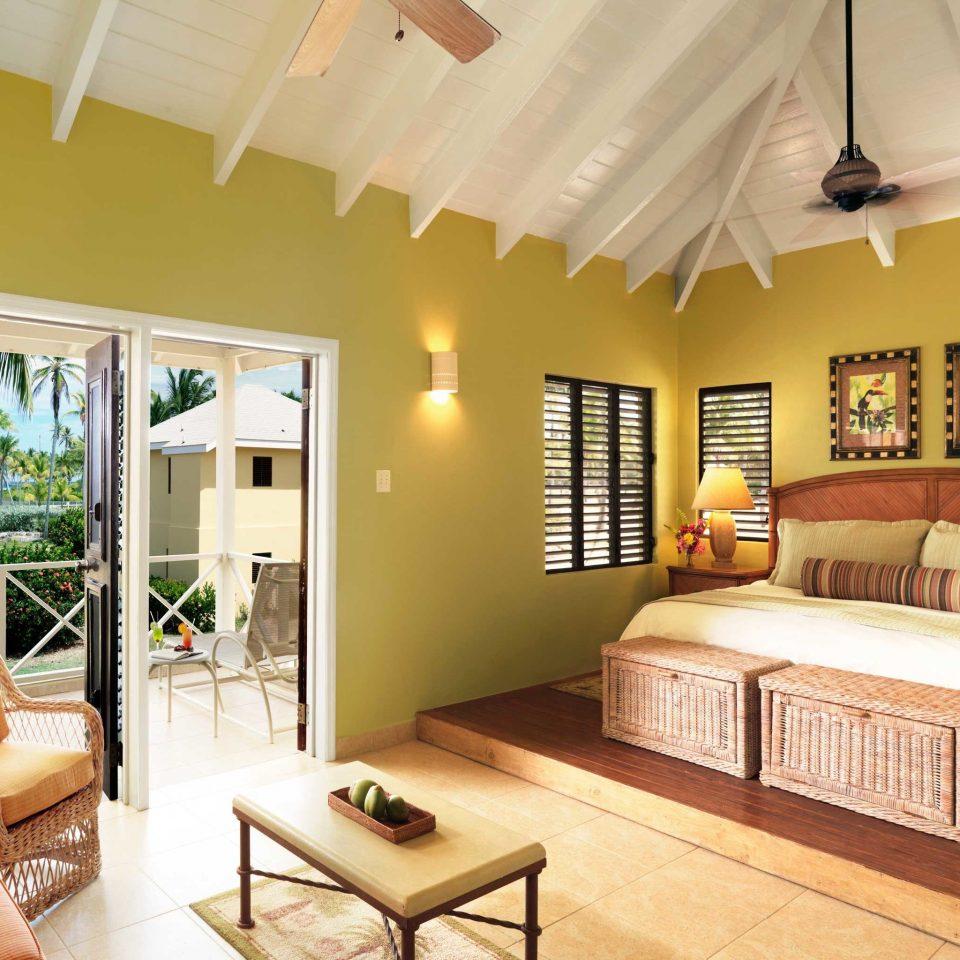 Balcony Bedroom Lounge Luxury Suite sofa property living room yellow home Villa cottage condominium flat