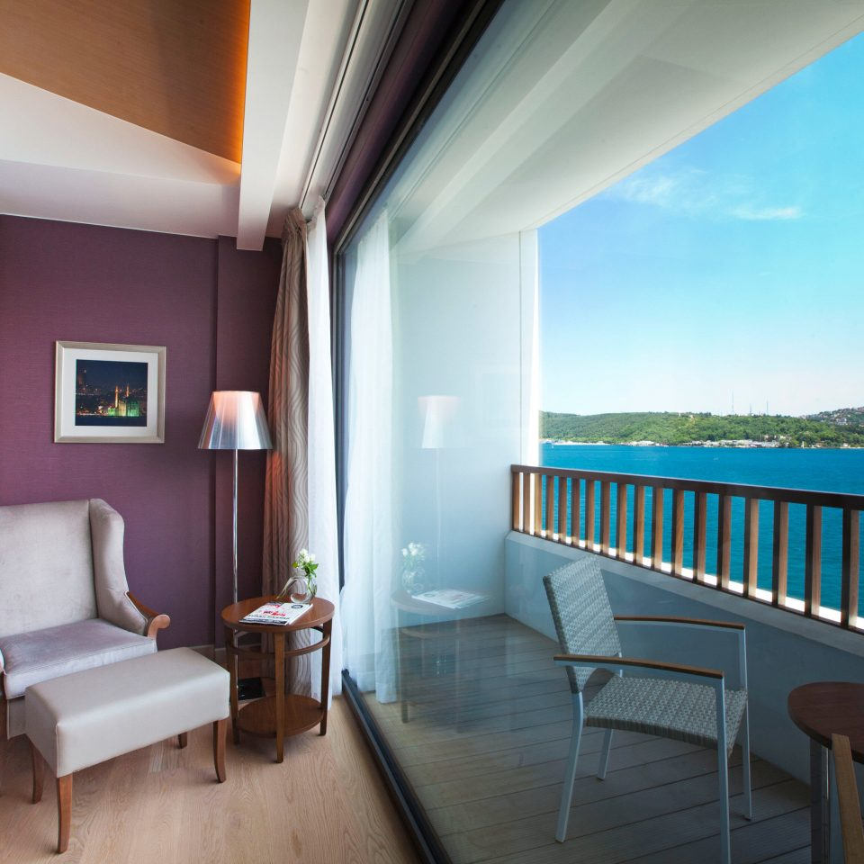 Balcony Lounge Luxury Romantic Scenic views Waterfront chair property condominium Resort Suite Villa home cottage living room Bedroom